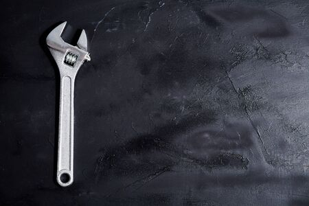 Home servises. Customer service and client support. Wrench on the blackboard. Copy space, background.