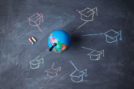 Global online education and e-learning. Webinar and language school. Globe, and symbols graduate caps.
