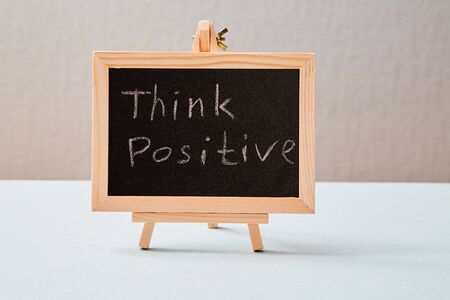 Positive thinking or Optimistic Attitude and Happy Concept. The inscription on the chalkboard.