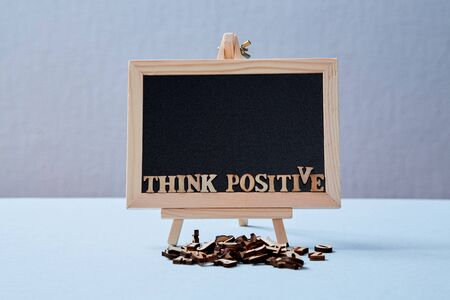 Positive Attitude, Happy and optimistic thinking Concept. The inscription think positive on the blackboard. Mockup.