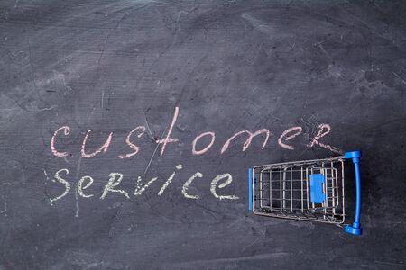 Home servises. Customer service, client support. Copy space. Inscription customer service and shopping basket. Reklamní fotografie