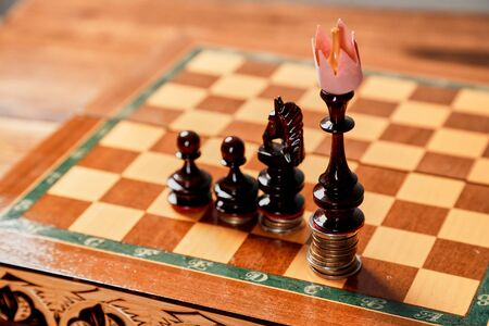 Chess game, leadership and competition concept. Chess king in a paper crown 写真素材