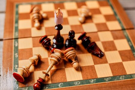 Chess game, business leader and competition concept. Chess king and losing pieces 写真素材 - 130103593