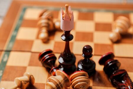 Business battle and strategy. Business game, leader and competition concept. Chess king and losing pieces