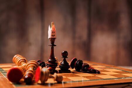 Business game, leader and competition concept. Chess king in the crown 写真素材