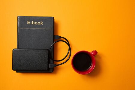 E-library and e-book. E-learning and online education and school. Hard drive, and a cup of coffee