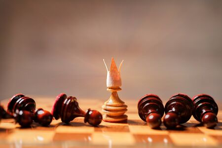 King, leadership and business strategy. Board game. A pawn with a crown on its head 写真素材