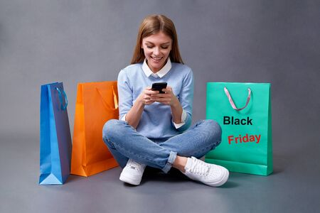 Sale, shopping, discount and Black Friday concept. Black friday. Woman with shopping bags.