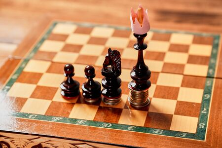 Winner or leadership. Fnance and investment, development concept. Chess pieces on stacks of coins.