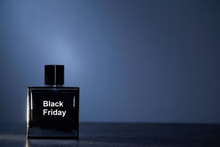 Shopping, sale or Black friday concept. Supermarket and discount. Bottle on grey background