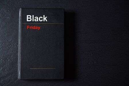 Black Friday, Shopping and commerce concept. Background, copy space. Book on black background