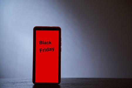 Sale, shopping, discount and e-commerce concept. Black friday. Silhouette of the phone on a gray background 写真素材