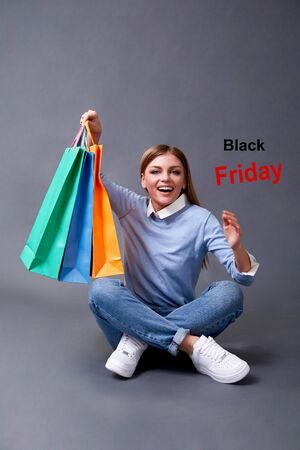 Happy girl with bags. Black Friday, Shopping and commerce concept. 写真素材