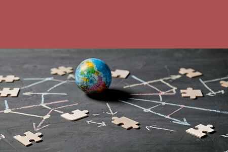 Networking or communication, blockchain, global technology, communities and e-marketing. Globe and puzzle piece