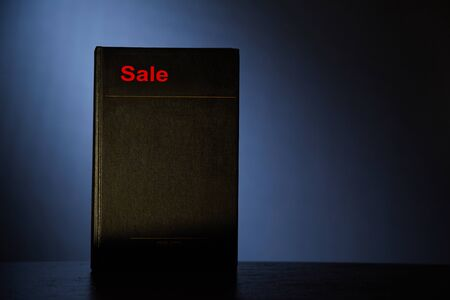 Black Friday, Shopping and commerce concept. Background, copy space. Book with an inscription on a gray background