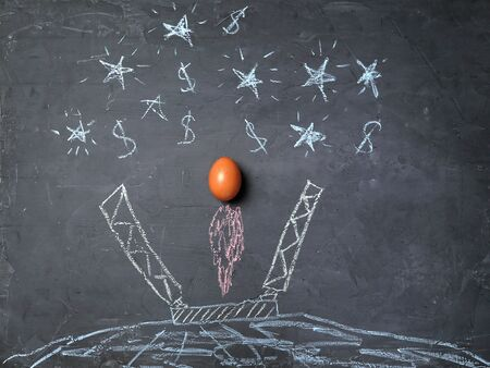 Start up and success. New business, aspirations, and investment concept. Egg soaring to success