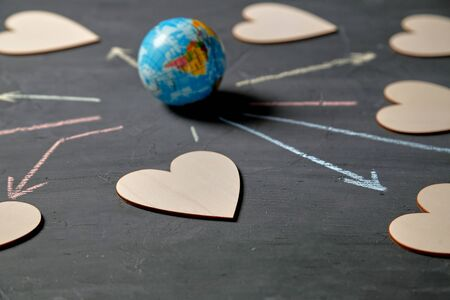 Internet or online dating and love. Global communication, networking and sharing concept. Globe and figures of hearts