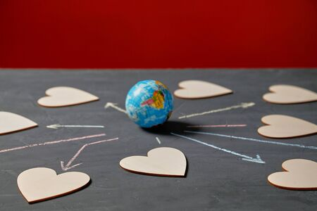 Global communication and networking. Internet or online dating, sharing and social media. Globe and figures of hearts