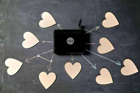 Internet or online dating. Global communication, networking and social media. router and hearts 写真素材