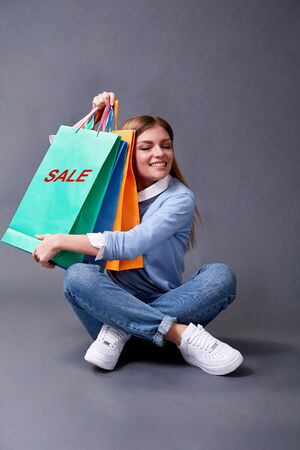 Black Friday, Shopping and commerce concept. Happy girl with bags.