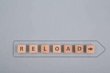 Reloading, overloading bar process. Uploading program. Restart. Reboot system. Wooden cubes with reload inscription