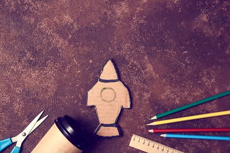 Start-up idea. New business start, copy space. Mockup style. Change for better concept. Paper rocket and stationery
