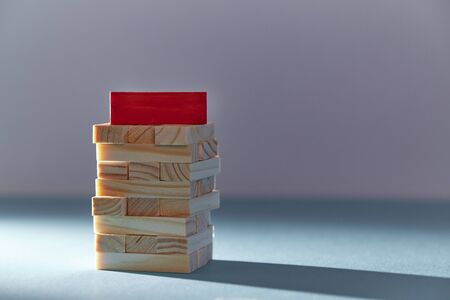 Tower of wooden cubes with red block on top. Stack of blank planks mockup template, place for text. Teamwork concept