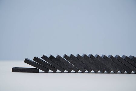 Domino effect background template. Planks falling down, copy space. Financial crisis. Total collapse, place for text.