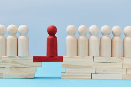 Not like everyone. Business risk. Leadership and superiority. People figures on bridge, one red person miniature on gap