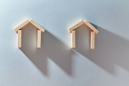 Houses of wooden planks mockup, copy space. Property investment. Real estate market. Models of home for creative design.