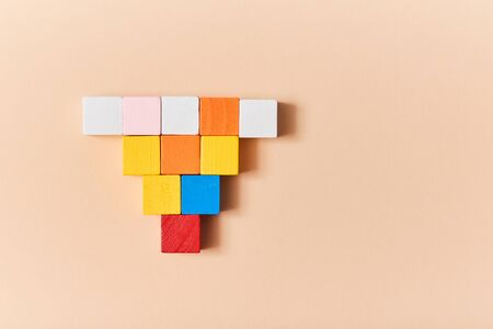 Empty wooden cubes mockup, copy space. Template with colourful blocks for creative design. Isolated on peach background
