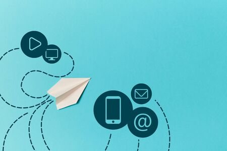 Paper plane and smartphone, email, monitor, play signs isolated on blue. E-mail marketing and delivery. SMM promotion