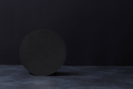 Black textured background and round-shaped form, copy space. Best price. Black friday. Final sale, discount. Night sale