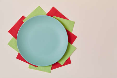 Table setting background. Holiday celebration. Festive dinner. Party concept. Top view of plate on colourful napkins