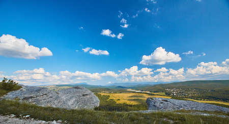 Freedom and Explore world. Landscape of Wild life. Sunny weather. Green mountains with village. High hills. Stok Fotoğraf