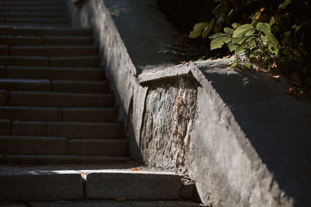 Empty staircase with curb. Sun light falling on ground. Street style, take break and architecture concept, copy space