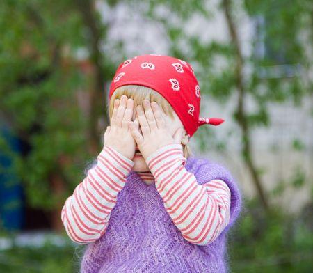 Little girl hiding Stock Photo