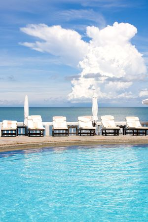 wealthy lifestyle: Swimming pool on a sunny day.Pattaya city in Thailand . Stock Photo