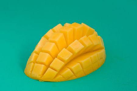 Ripe mango on a green background Stock Photo - 5541417