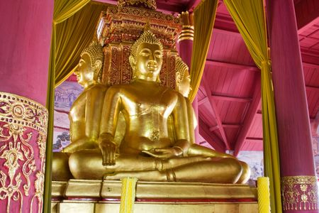 Buddha image in a temple at Thailand photo