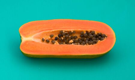 golden section: Papaya on a green background