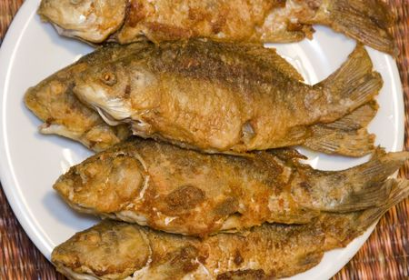 Fried fish in plate photo