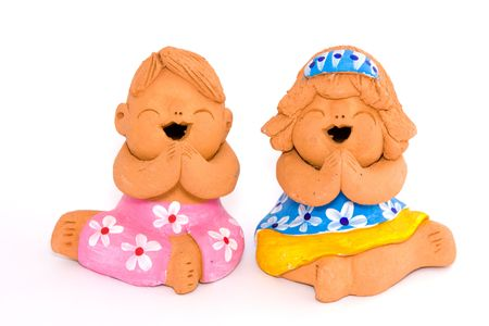 Boy and girl of clay figurine photo