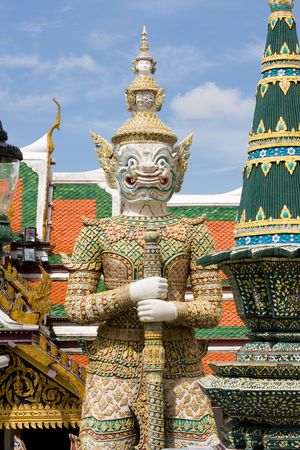 venerate: Guardian statue at the temple Wat phra kaeo in the Grand palace area in Bangkok, Thailand Stock Photo