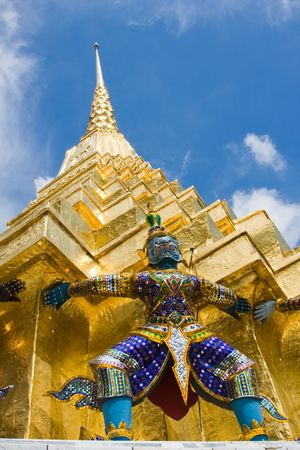 venerate: A kind of mythological soldier next to a chedi in Grand Palace in Bangkok