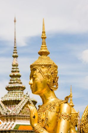 A kind of mythological soldier next to a chedi in Grand Palace in Bangkok