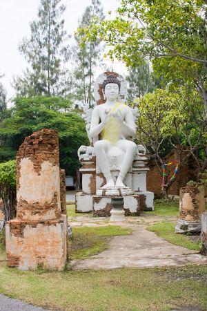 venerate: Stone statue of a Buddha