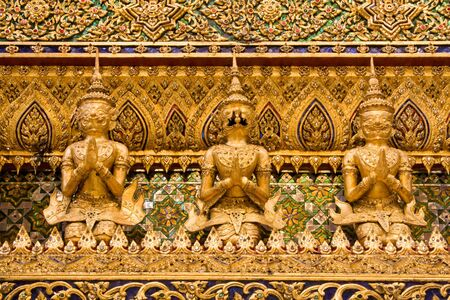 venerate: A kind of mythological soldier next to a chedi in Grand Palace.Thailand, Bangkok.