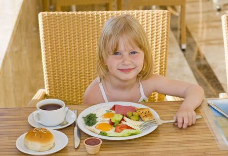 Young girl eating in restaurant  photo