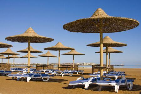Beach on a sunny day. Hurghada city in Egypt. photo